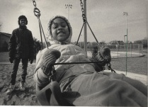 Robert Williams, 13, pushed his niece, Candice Buynum, 3, on a swing at Clinton Rose Park. The pair were out to enjoy the sunny weather white it lasted. Monday brought cloudy skies and colder weather, and the forecast calls for rain and sleet. Monday, December 1, 1986.