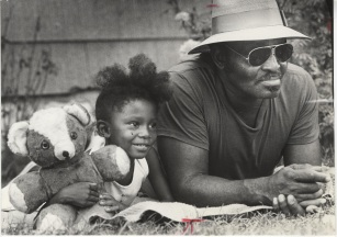 Tina Milton, 5, held her teddy bear while watching a boxing match with James Taylor during a Going Back to School Street Festival on 5th St. between Walnut and Reservoir. September 1, 1977.