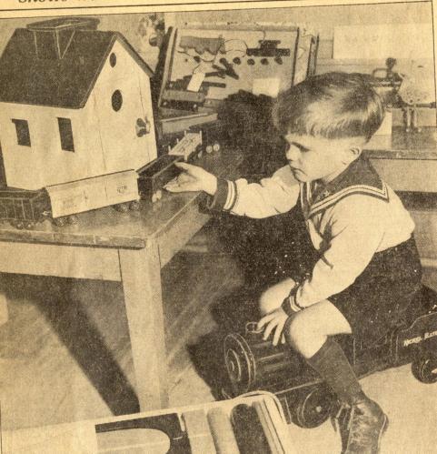 Milwaukee Boy Playing with Train Set