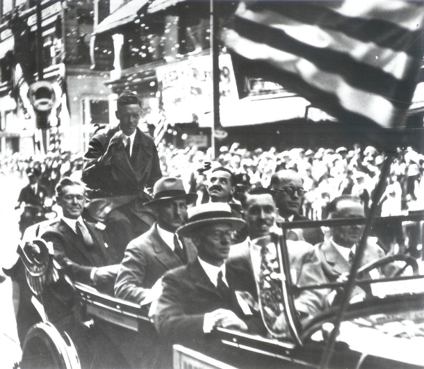 Charles Lindbergh, seated on the right-hand side of Mayor Daniel Hoan.